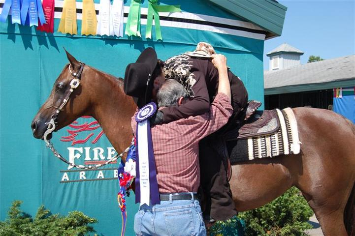 Kat and Grandfather embrace in memory of Khemosha Bey //, as Kat and Sierra Defended his titles in Western Horsemanship and Equitation